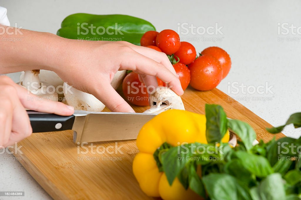 close up of hands chopping food vegetables royalty-free stock photo