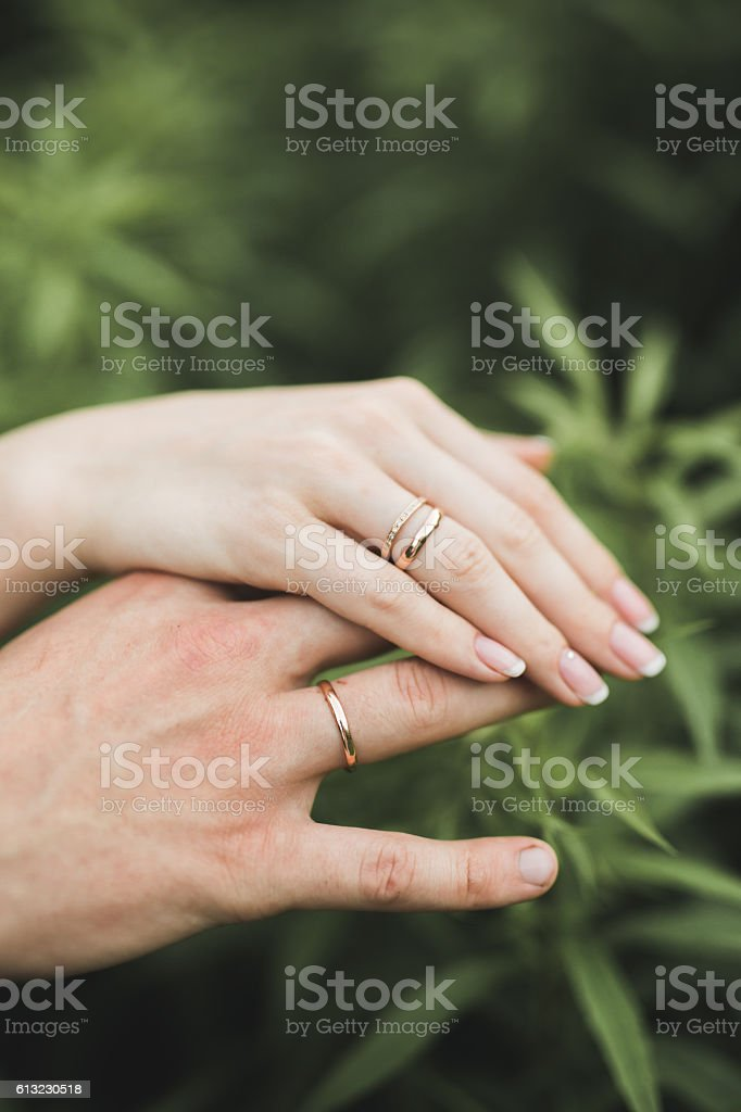 Close up of hands  couple showing the wedding ring stock photo