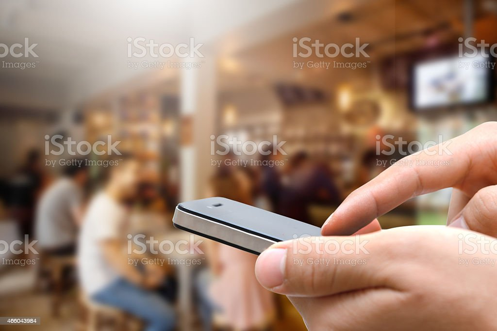 Close up of hands man using his cell phone stock photo