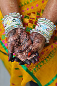 Close up of hands of Indian woman with Mehendi