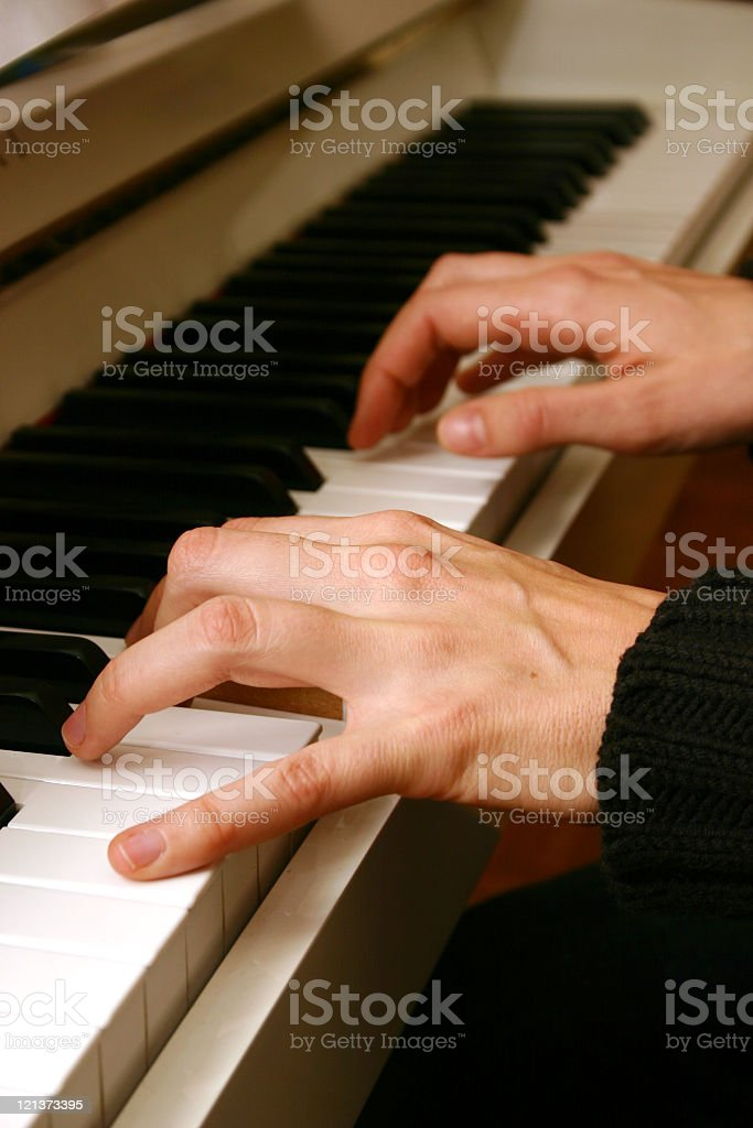 Close up of hands on piano stock photo
