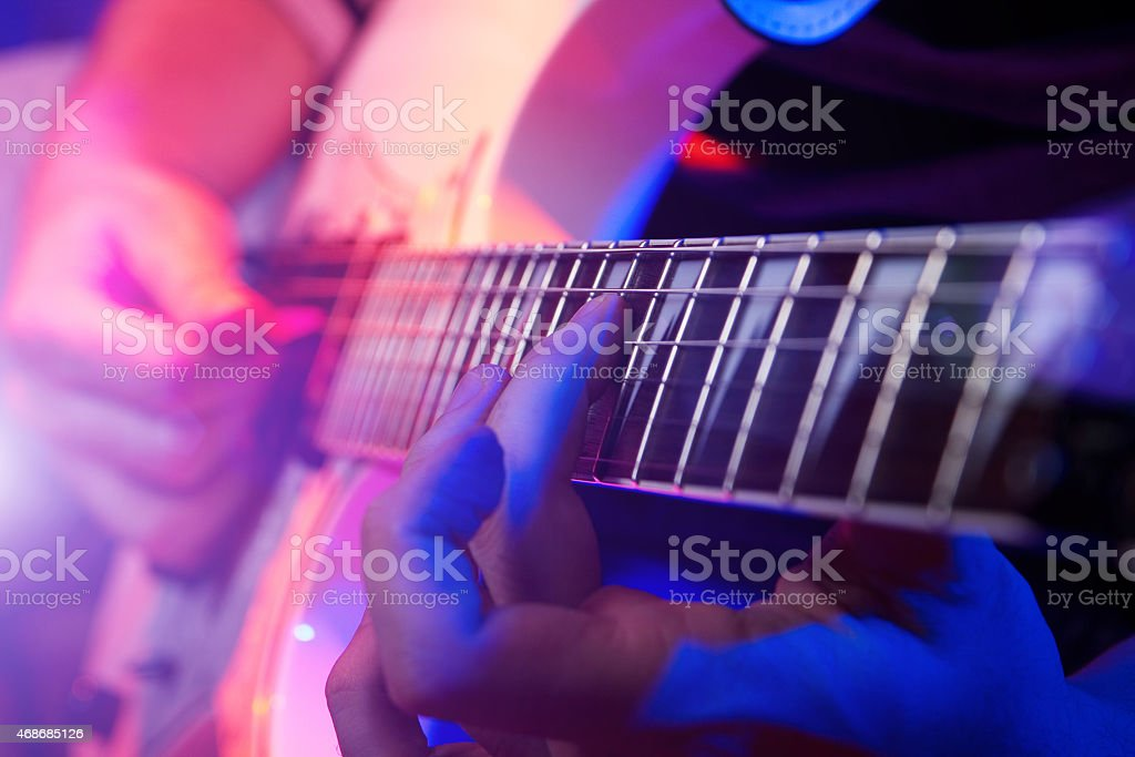 Close up of hands playing a guitar stock photo