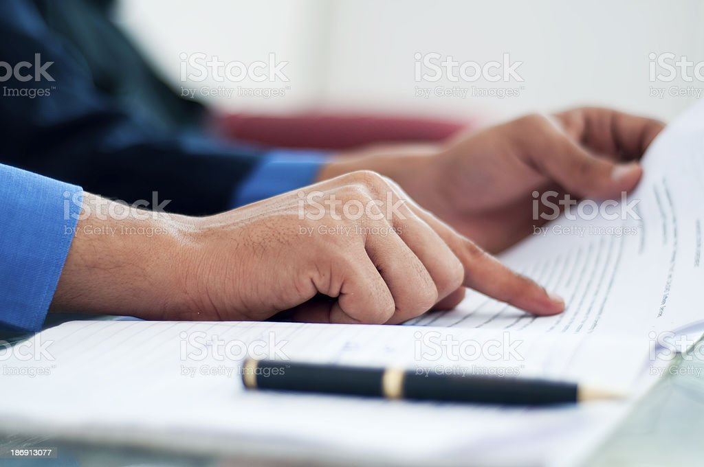 Close up of hands verifying business document stock photo