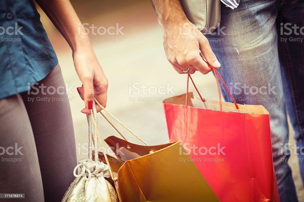 Close up of hands with shopping bags stock photo