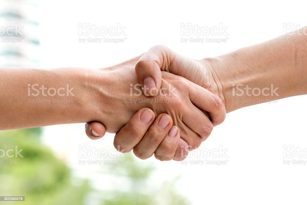 Close up of handshake of business partner after agreement stock photo