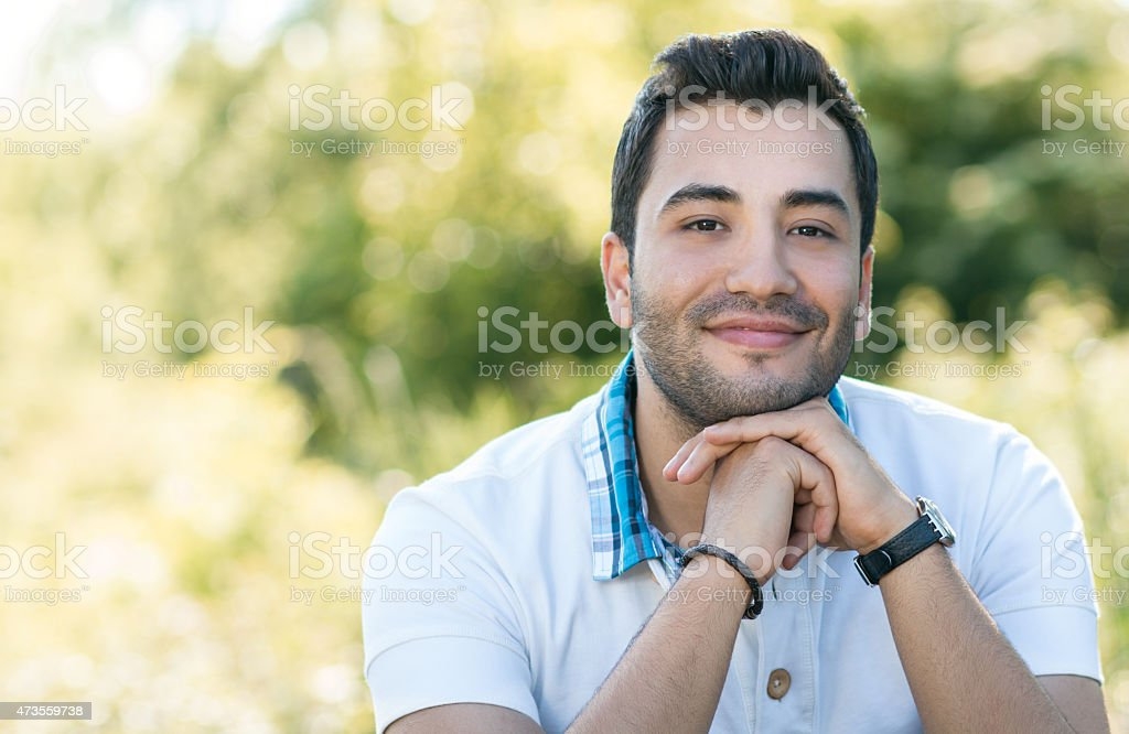 Close up of handsome latin man. stock photo