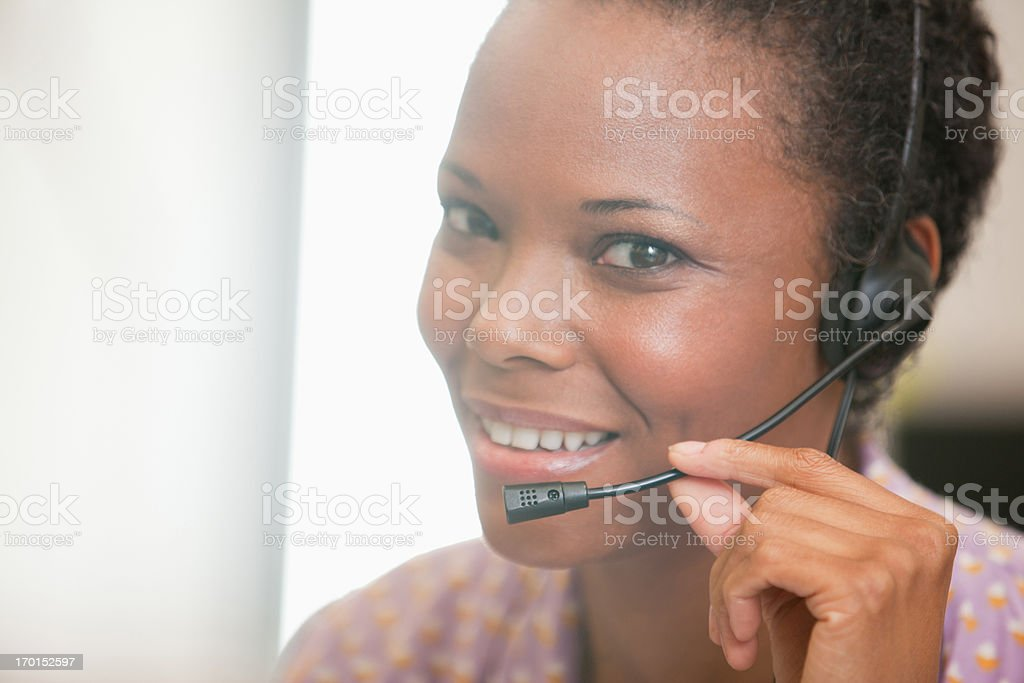 Close up of happy businesswoman using headset royalty-free stock photo