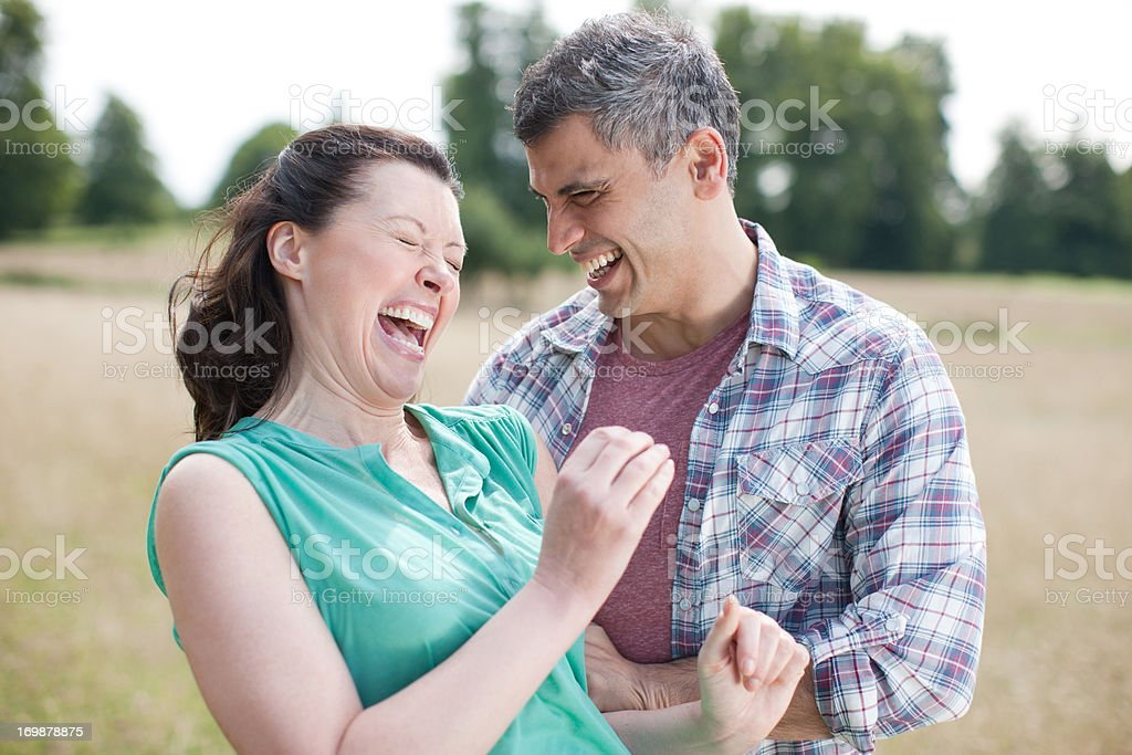 Close up of happy couple hugging stock photo