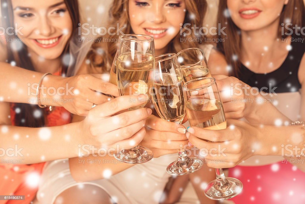 Close up of happy girls celebrating new year party stock photo