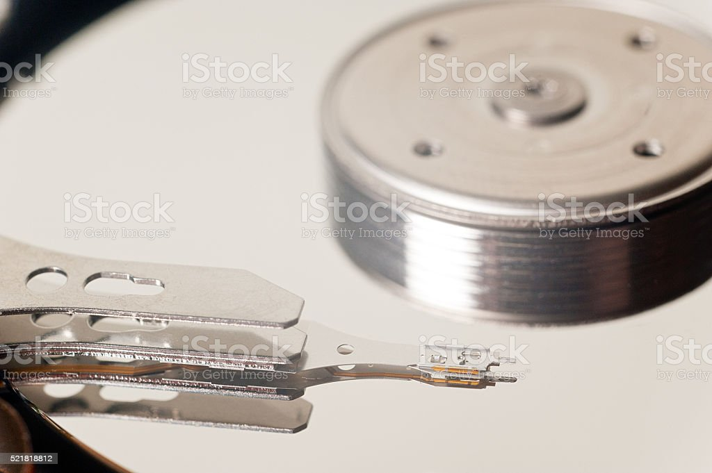 Close up of hard disk internal mechanism hardware stock photo