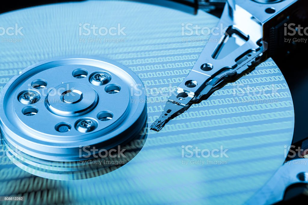 Close up of hard disk with binary language reflection stock photo