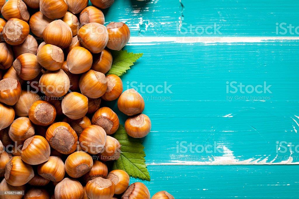 Close up of hazelnut on turquoise table stock photo