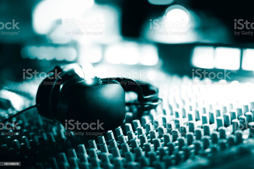 Close up of headphones on audio mixing board royalty-free stock photo