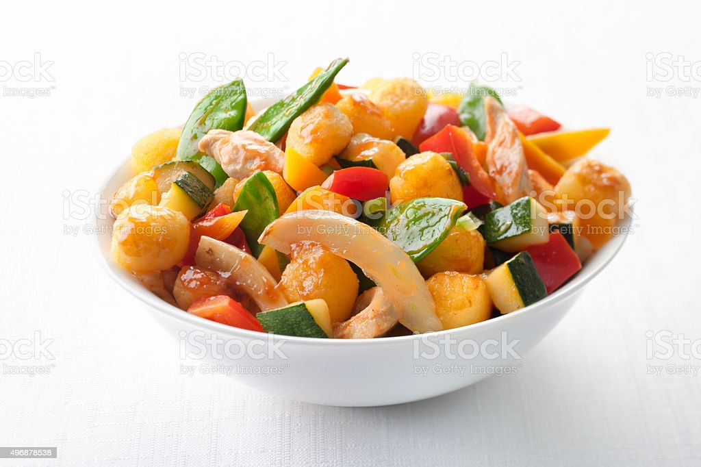 Close up of healthy vegetable salad on white tablecloth stock photo