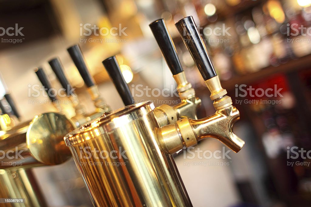 Close up of highly polished, golden beer taps  royalty-free stock photo