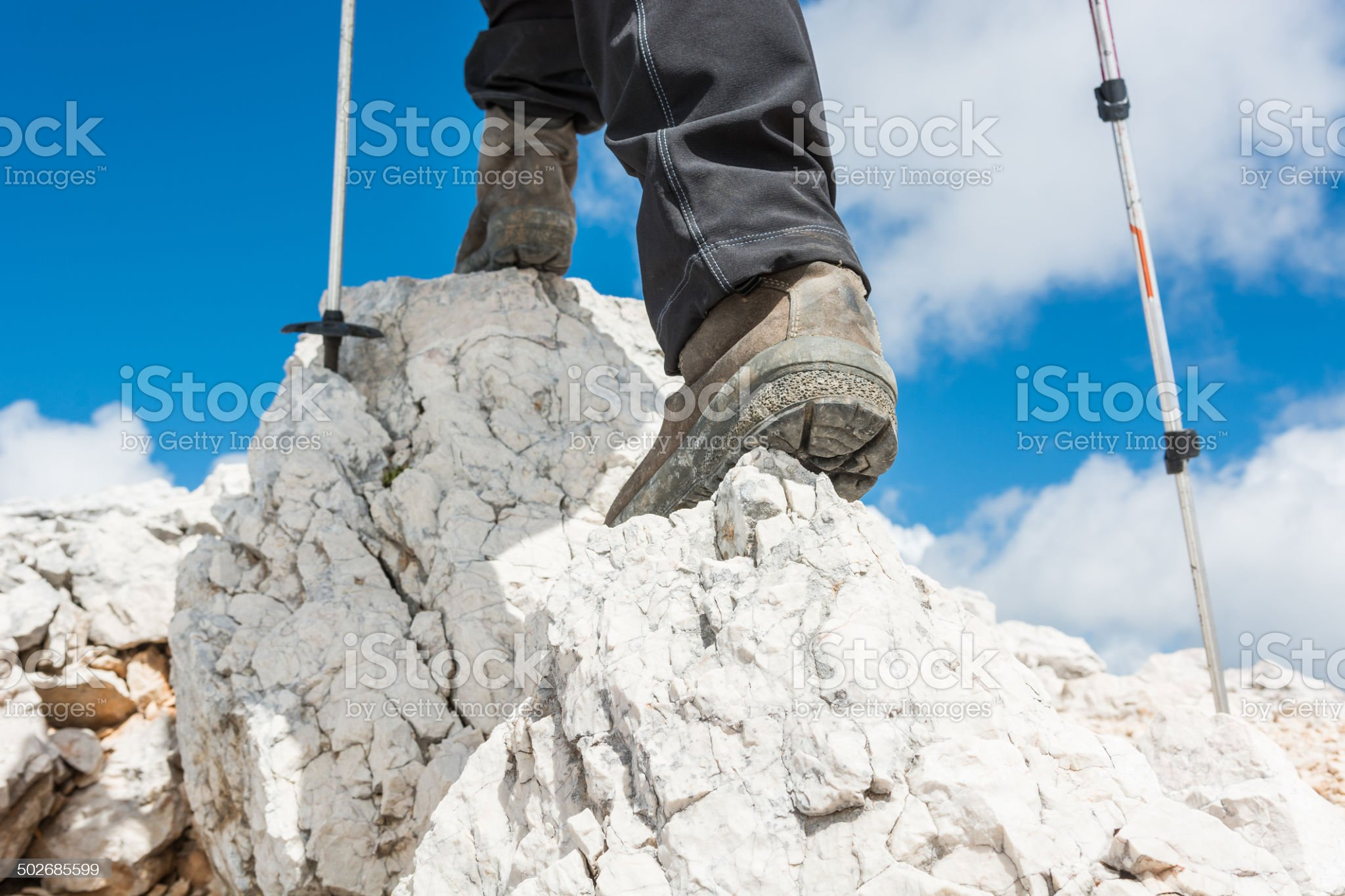 Close up of hiking shoes and trekking poles royalty-free stock photo