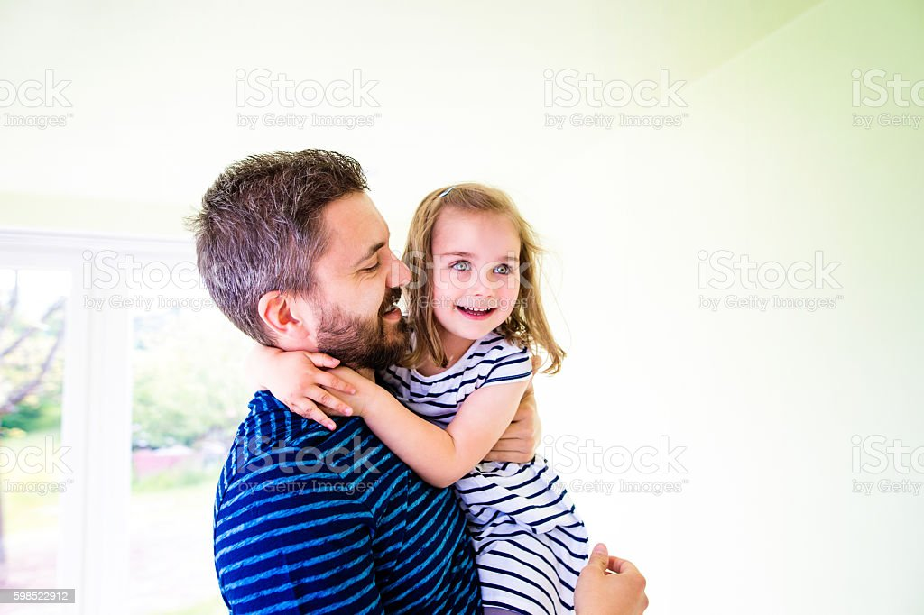 Close up of hipster father holding his little daughter stock photo