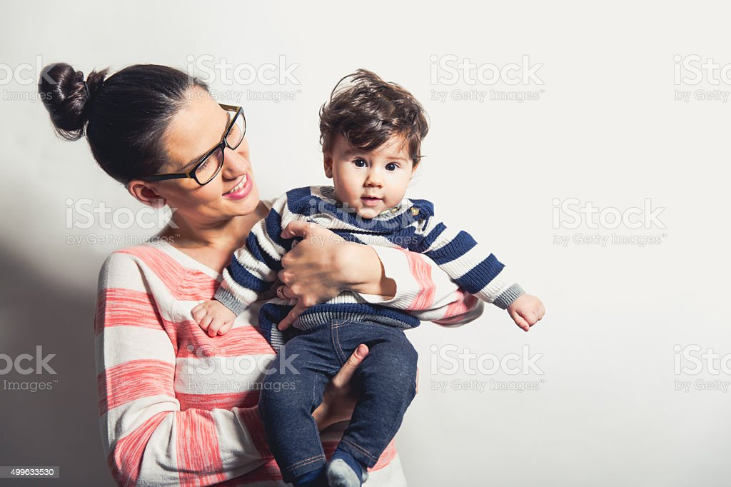 Close up of Hispanic female holding infant stock photo