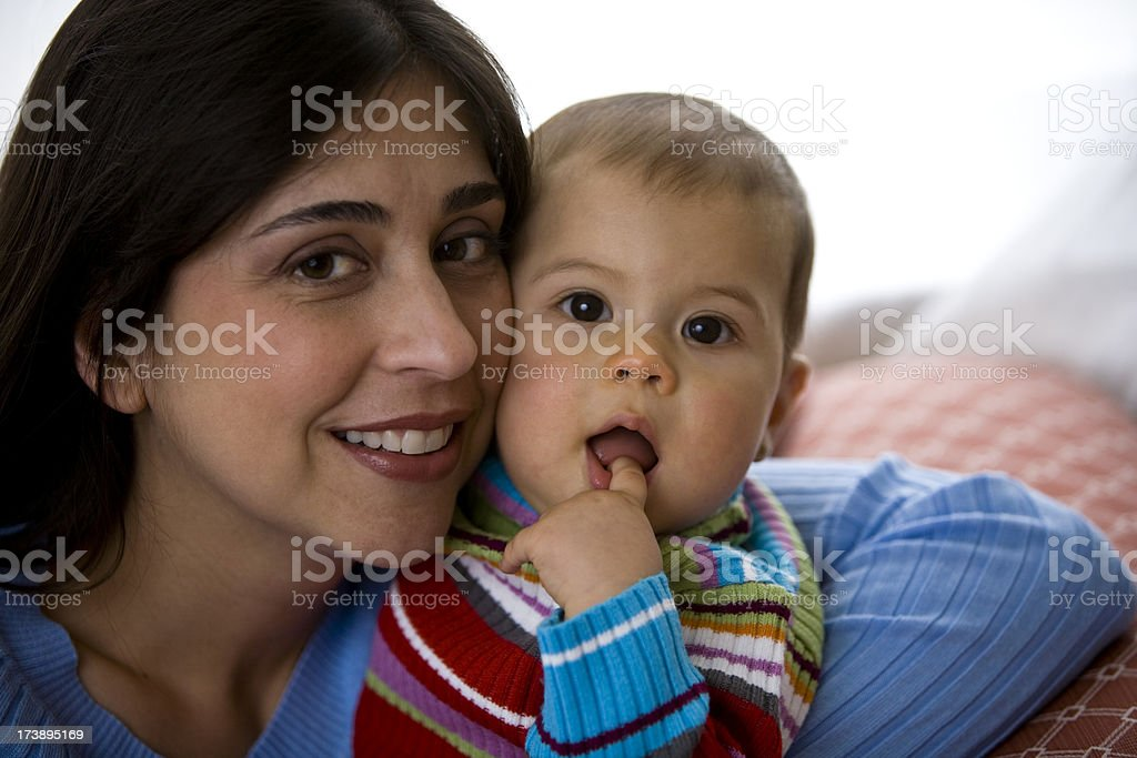 Close up of Hispanic female mother with baby daughter royalty-free stock photo