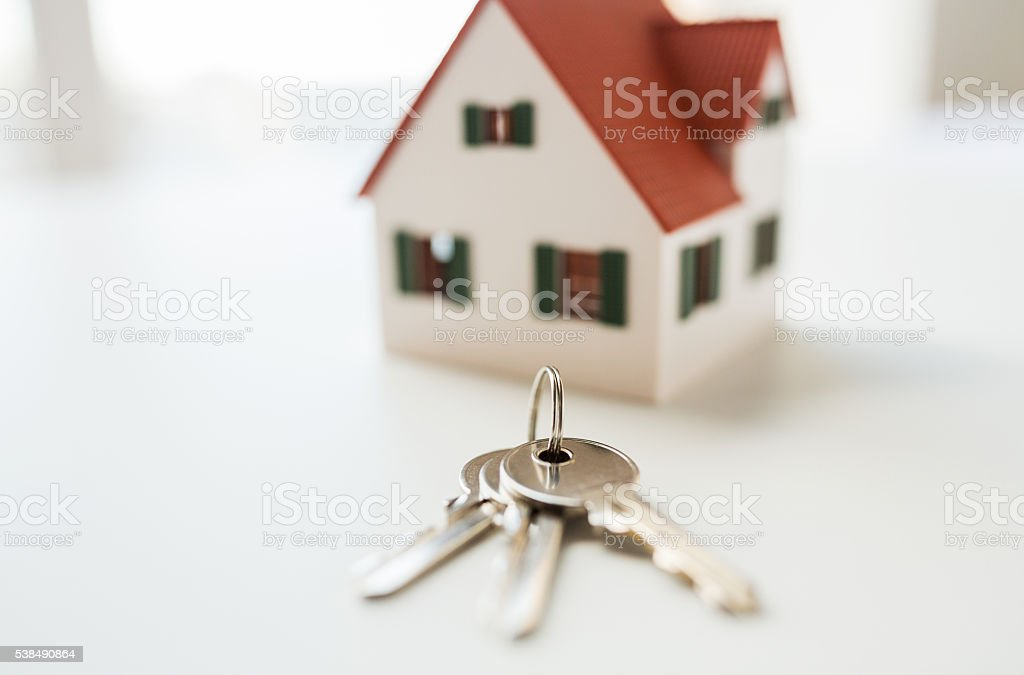 close up of home model and house keys stock photo