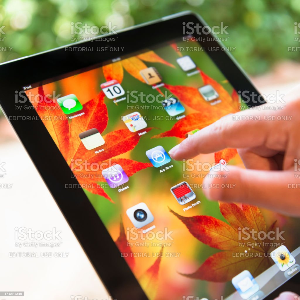 Close up of human finger pointing on ipad 3 screen royalty-free stock photo