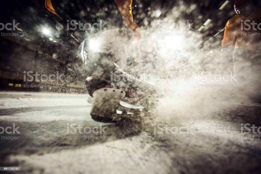 Close up of ice hockey player in motion on ice hockey rink. stock photo