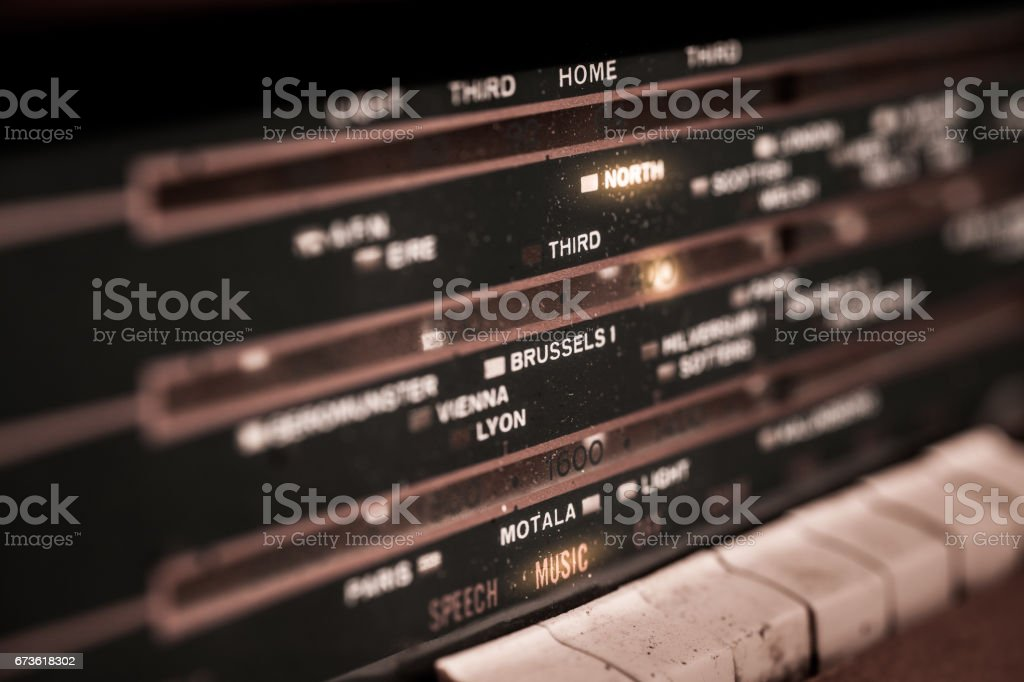 Close up of illuminated dial from an old radio set stock photo