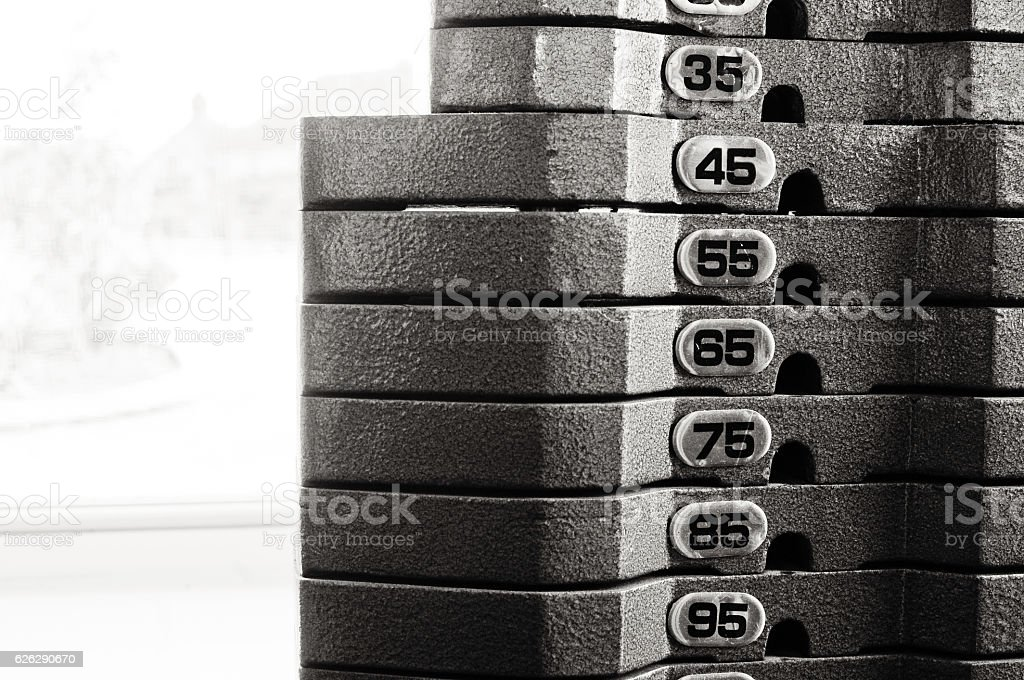Close up of indoor weight stack equipment stock photo
