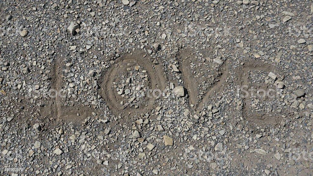 Close up of inscription love on pebble beach, free copyspace stock photo