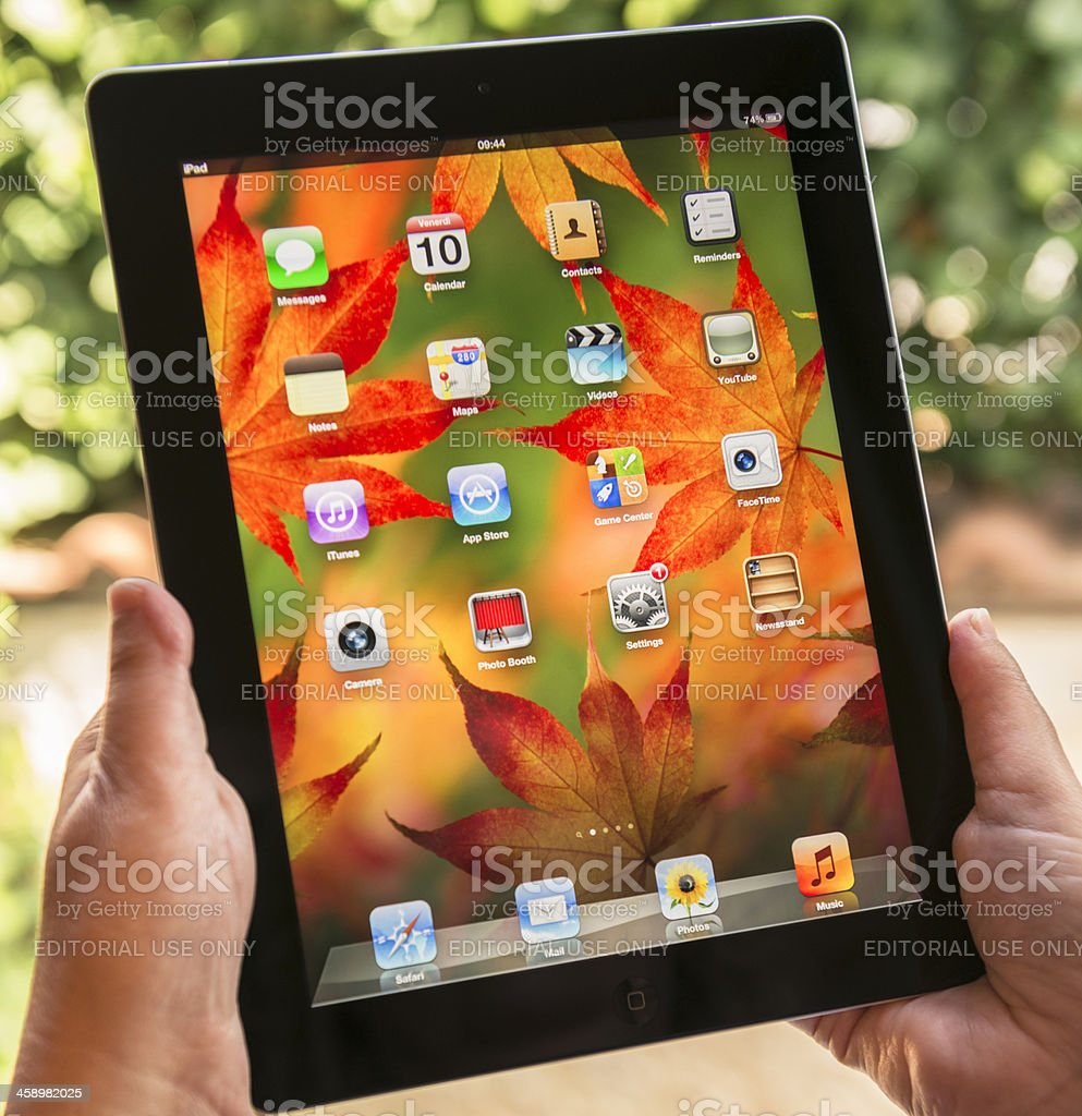 Close up of ipad 3 with autumn background screen royalty-free stock photo