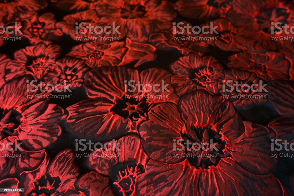 Close up of jacquard cloth with crimson red flowers stock photo