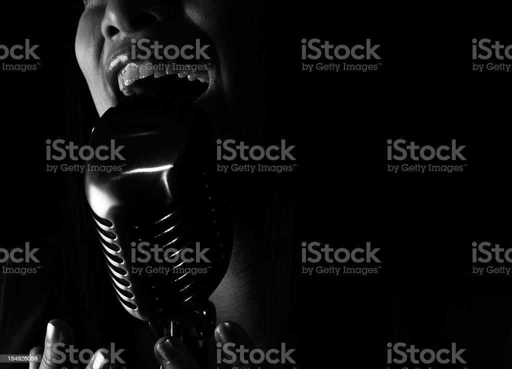 Close up of jazz Singer singing into a microphone stock photo