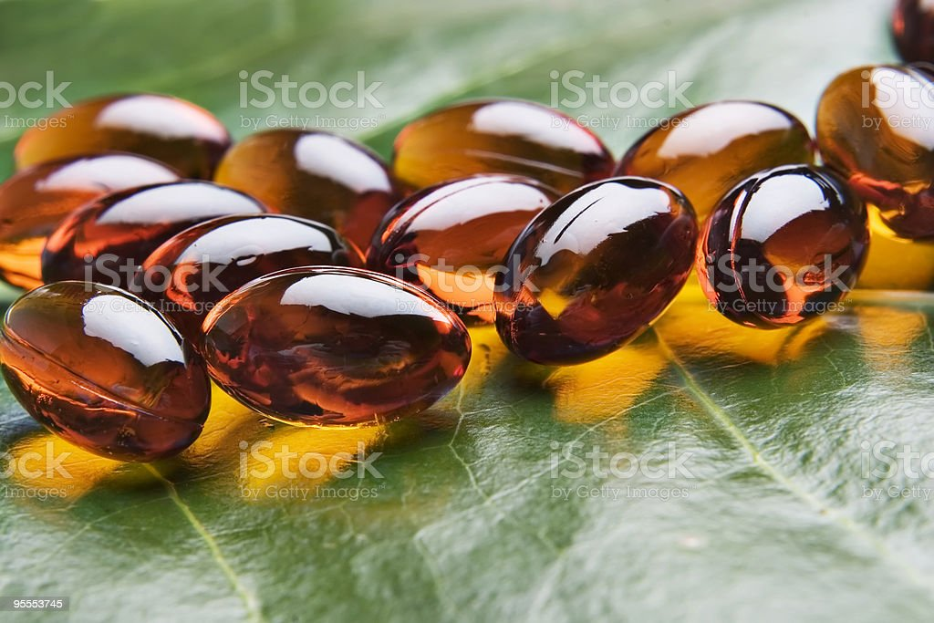 Close up of jelly vitamins on a leaf royalty-free stock photo