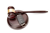 Close up of judge gavel and car keys over soundboard