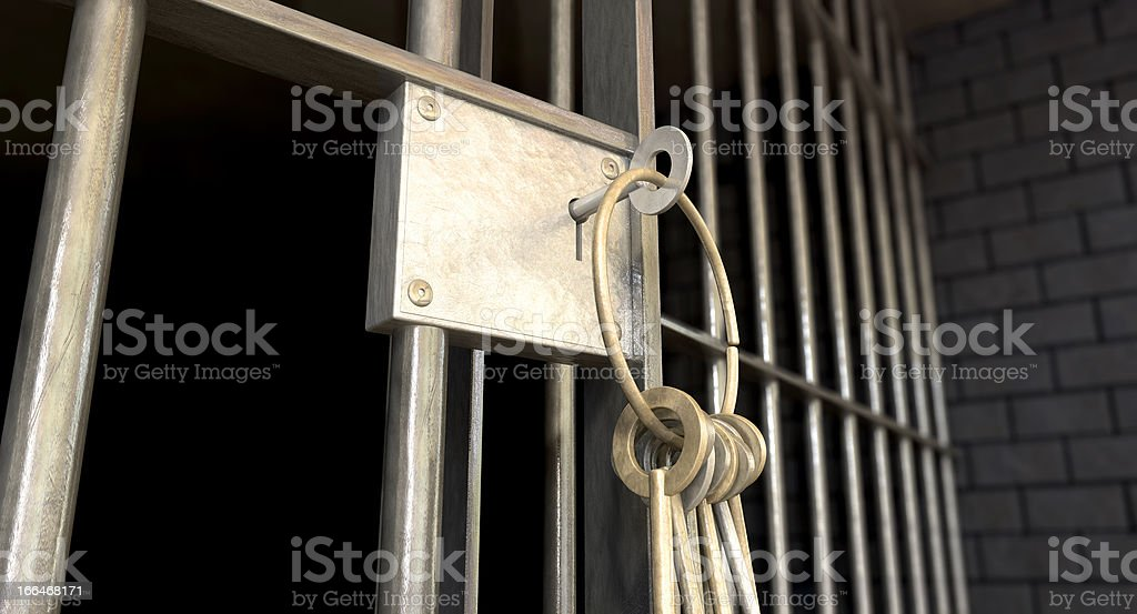 Close up of keys in jail cell lock stock photo