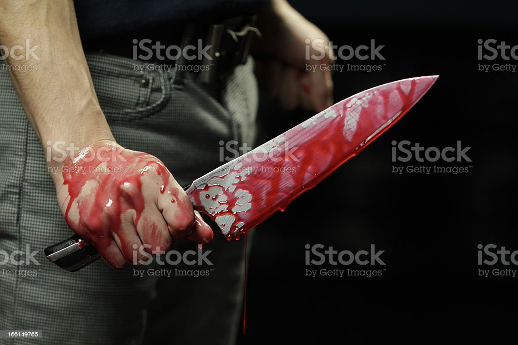 Close up of knife with blood dripping stock photo