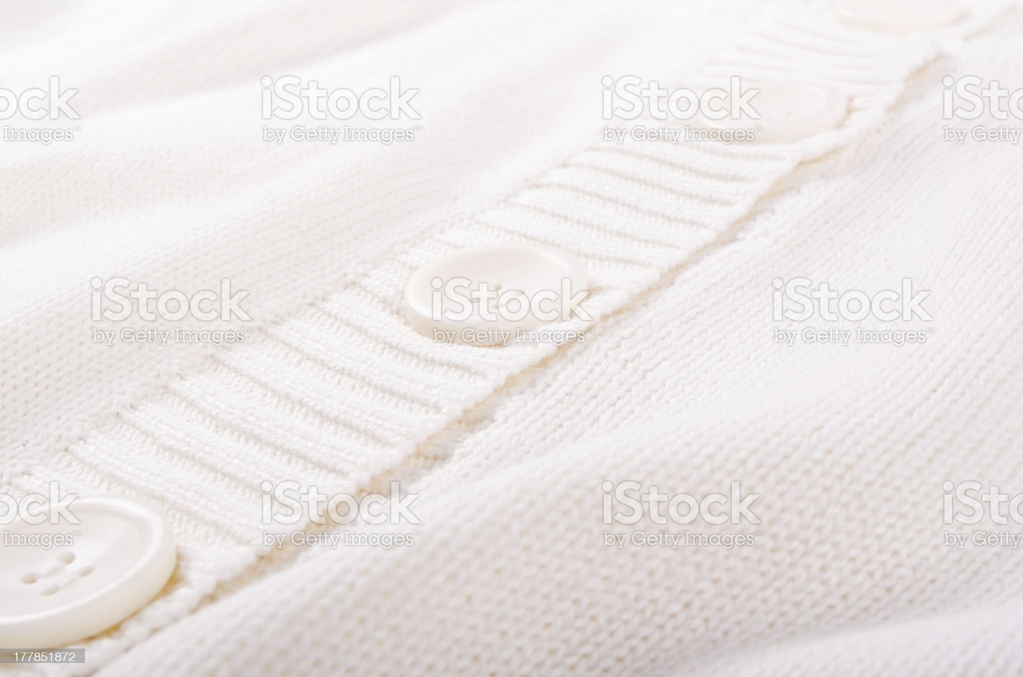 Close up of knitted white sweater with buttons royalty-free stock photo