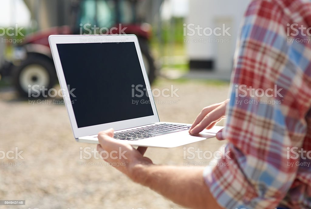 Close up of laptop used on the farm stock photo