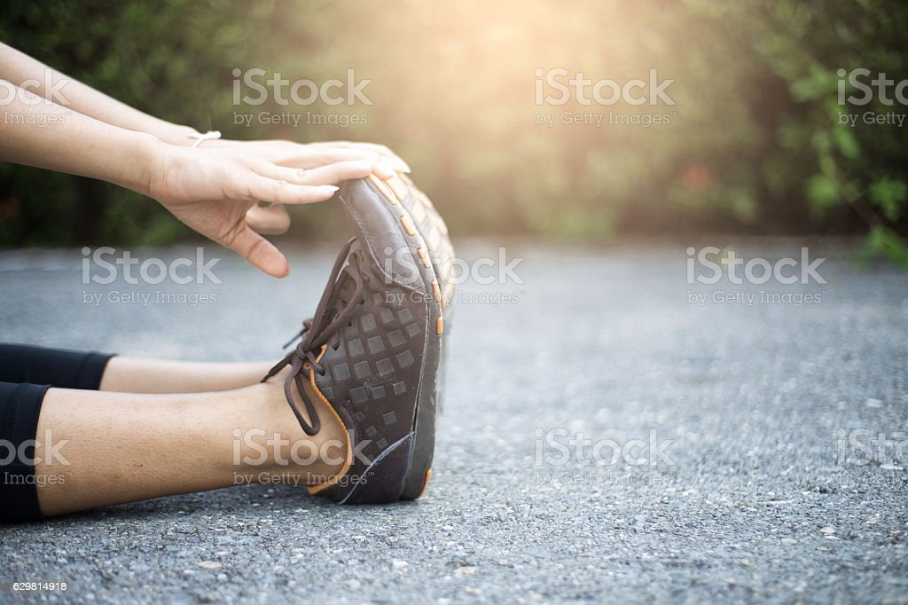 Close up of legs and hand of women. stock photo