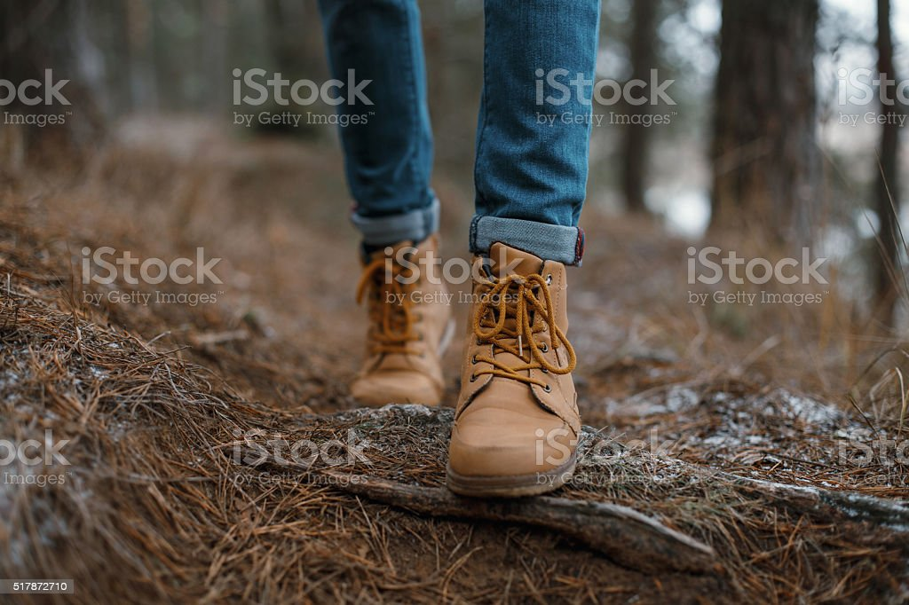 Close up of legs walking in the forest royalty-free stock photo
