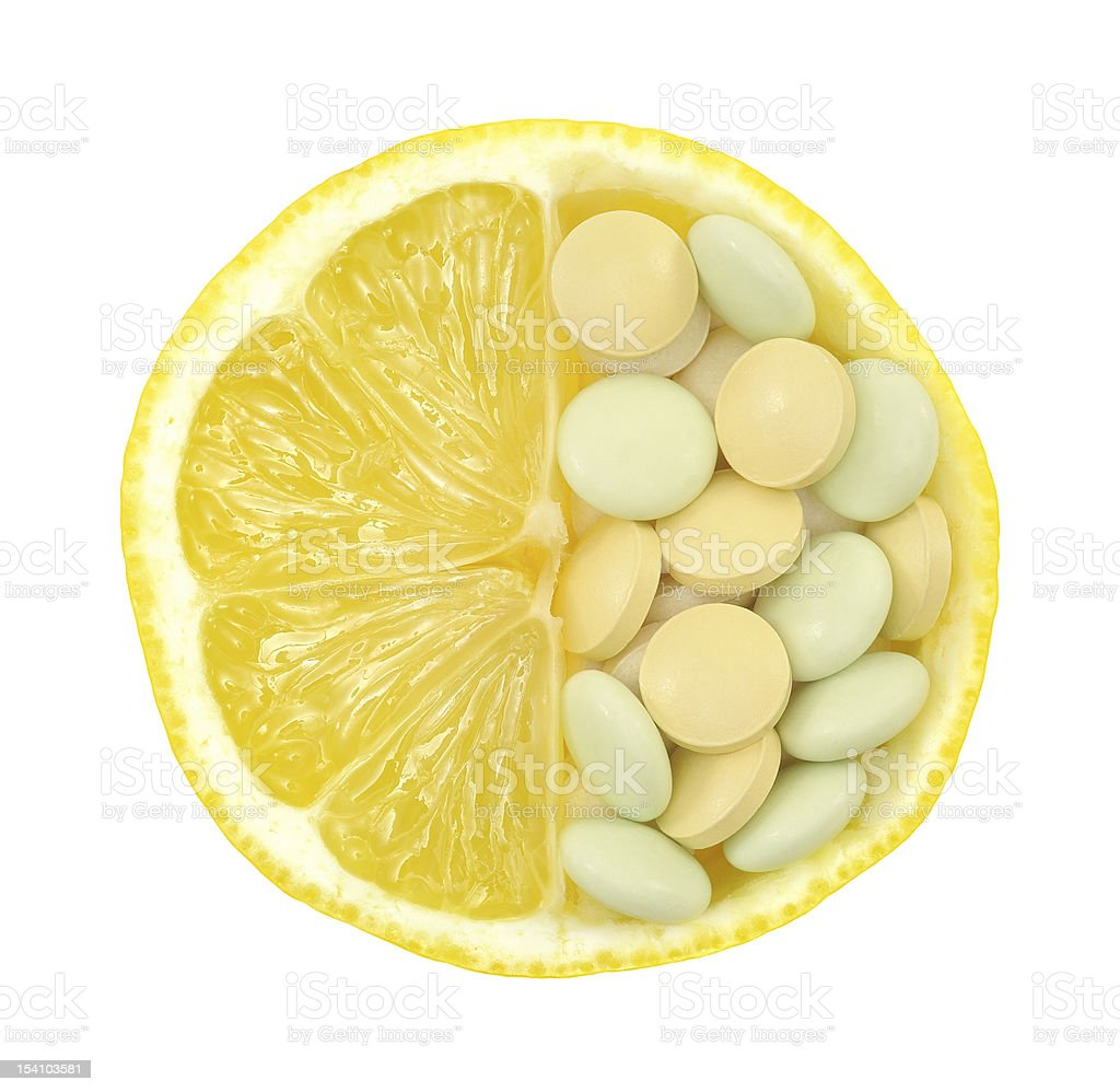 Close up of lemon and pills isolated – vitamin concept royalty-free stock photo