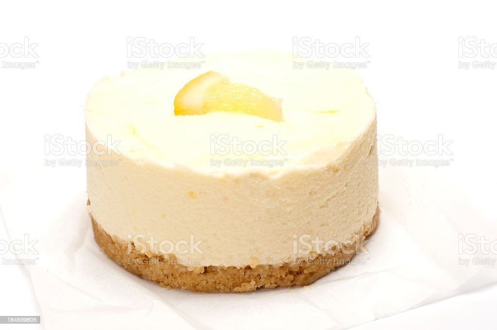 Close up of lemon cheesecake on white towel stock photo