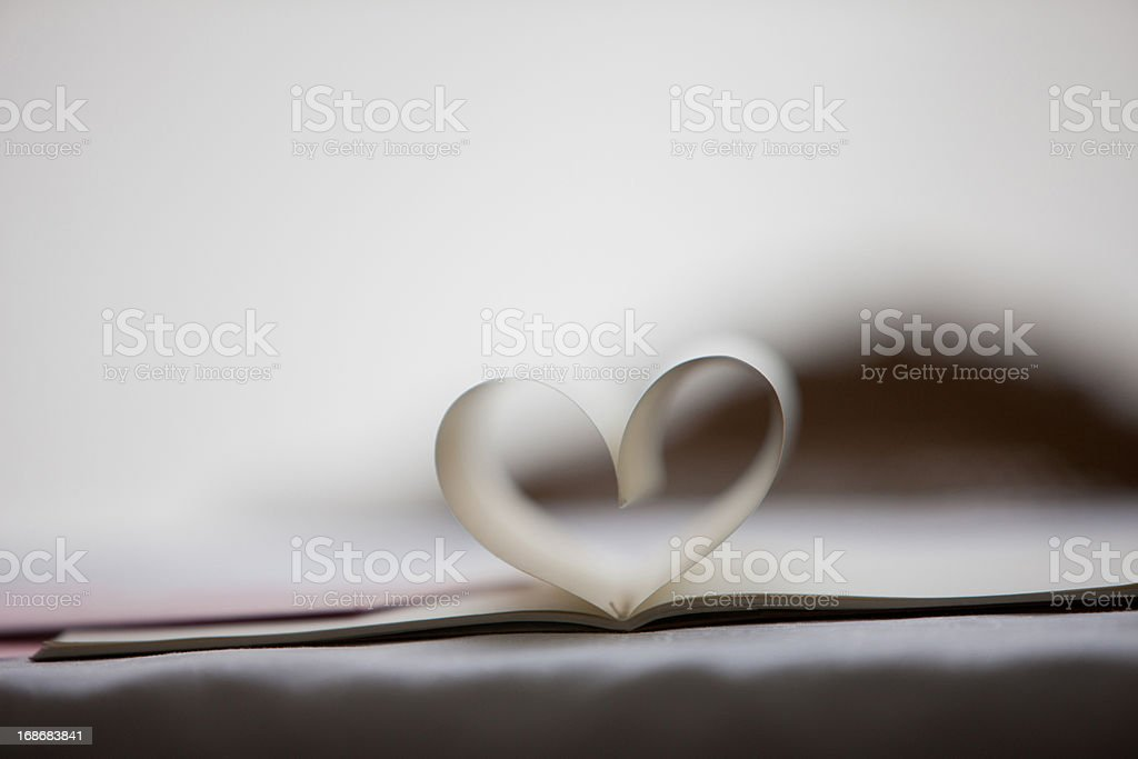 Close up of lipstick kiss on envelope and pages of notebook forming heart-shape royalty-free stock photo