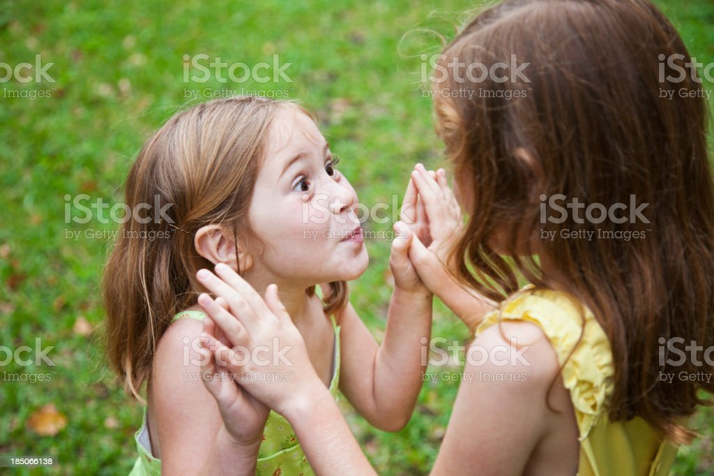 Close up of little girls playing stock photo