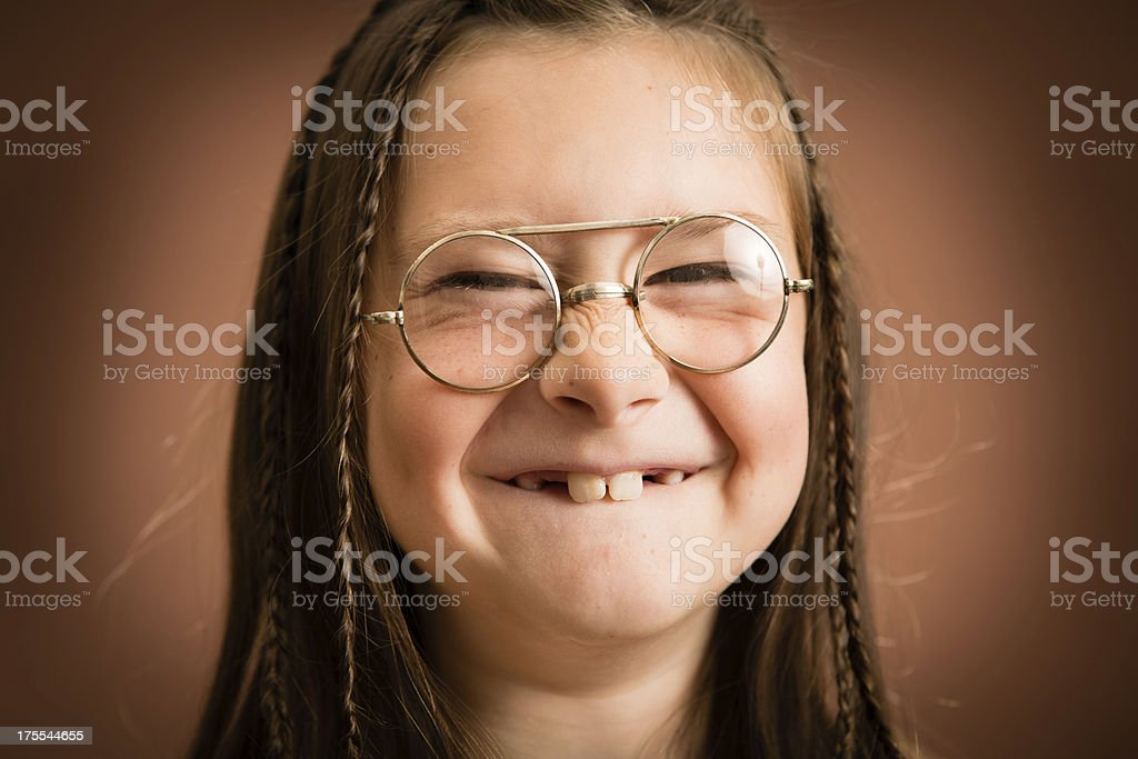 Close Up of Little, Nerdy Girl With Cheesy Grin royalty-free stock photo