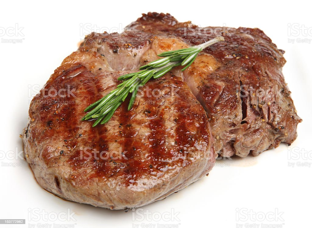 Close up of lone rib eye steak on white stock photo