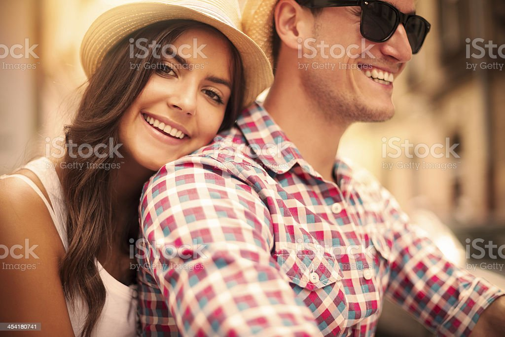 Close up of loving couple riding on bike stock photo