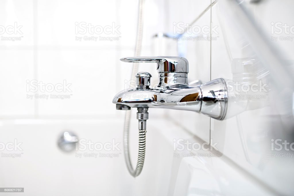 close up of luxury bathroom tap and bathtub stock photo