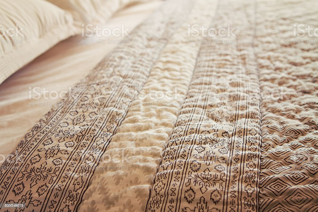 Close up of luxury bed quilt cover and pillows horizontal stock photo