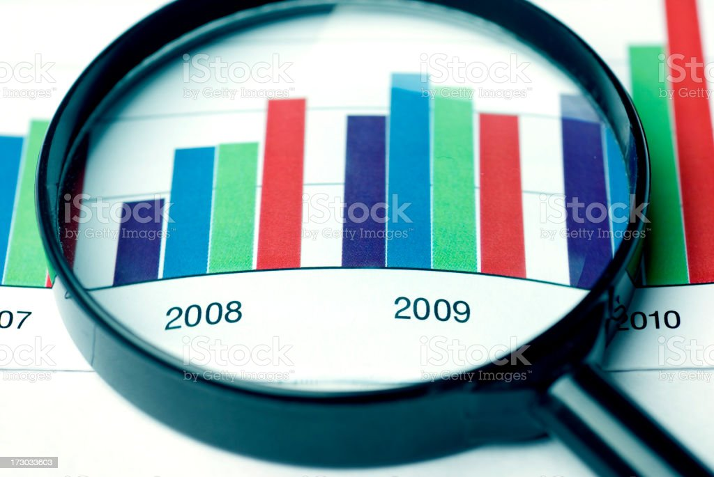 close up of magnifying glass and chart royalty-free stock photo